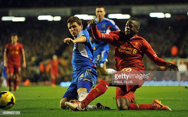 Hull City's Northern Irish defender Alex Bruce blocks Liverpool's French defender Aly Cissokho during the English Premier League football match...