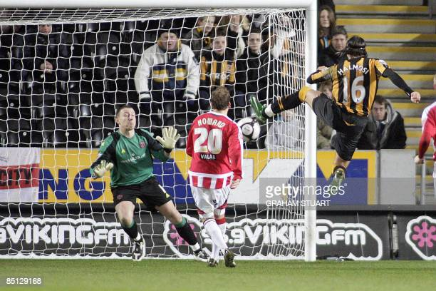 Hull City's Peter Halmosi shoots and scores past Sheffield United's Paddy Kenny during an English FA Cup fifth round replay football match at the KC...