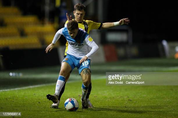 Hull City's Regan Slater shields the ball from Harrogate Town's Lloyd Kerry during the EFL Trophy Northern Group H match between Harrogate Town and...