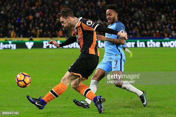 Hull City's Scottish defender Andrew Robertson vies with Manchester City's English midfielder Raheem Sterling during the English Premier League...