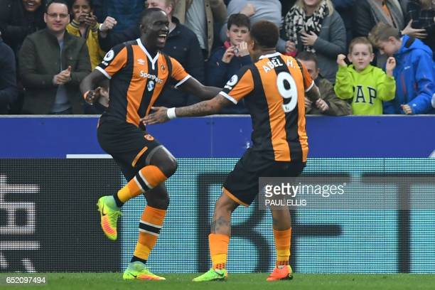 Hull City's Senegalese striker Oumar Niasse celebrates with Hull City's Uruguayan striker Abel Hernandez after scoring the opening goal of the...