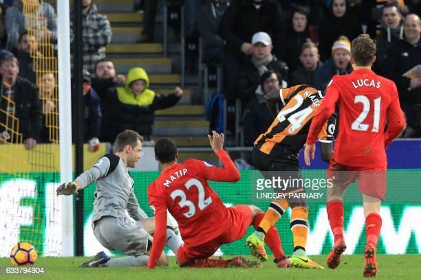 Hull City's Senegalese striker Oumar Niasse scores their second goal past Liverpool's Belgian goalkeeper Simon Mignolet during the English Premier...