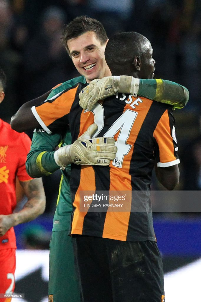 Hull City's Swiss goalkeeper Eldin Jakupovic (L0 celebrates with Hull City's Senegalese striker Oumar Niasse on the pitch after the English Premier League football match between Hull City and Liverpool at the KCOM Stadium in Kingston upon Hull, north east England on February 4, 2017. Hull won the game 2-0. / AFP / Lindsey PARNABY / RESTRICTED TO EDITORIAL USE. No use with unauthorized audio, video, data, fixture lists, club/league logos or 'live' services. Online in-match use limited to 75 images, no video emulation. No use in betting, games or single club/league/player publications. /