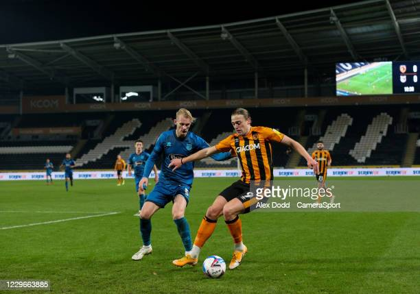 Hull City's Tom Eaves shields the ball from Grimsby Town's Ludvig Ohman during the EFL Papa John's Trophy Northern Group H match between Hull City...