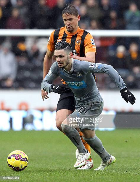 Hull City's Uruguayan forward Gaston Ramirez challenges Newcastle United's French midfielder Remy Cabella during the English Premier League football...