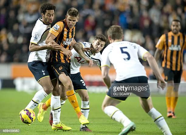 Hull City's Uruguayan midfielder Gaston Ramirez vies for the ball with Tottenham Hotspur's Belgian midfielder Mousa Dembele and English midfielder...