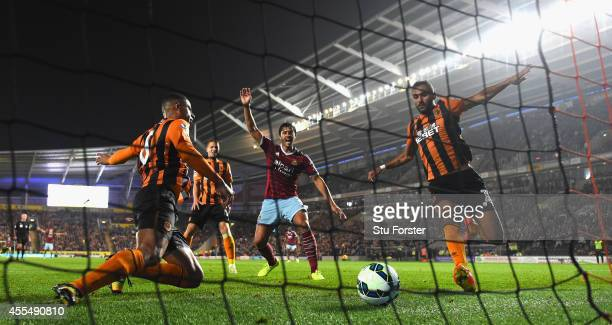 Hull defender Curtis Davies ldiverts the ball into his own net as West Ham defender James Tomkins celebrates the second West Ham goal during the...