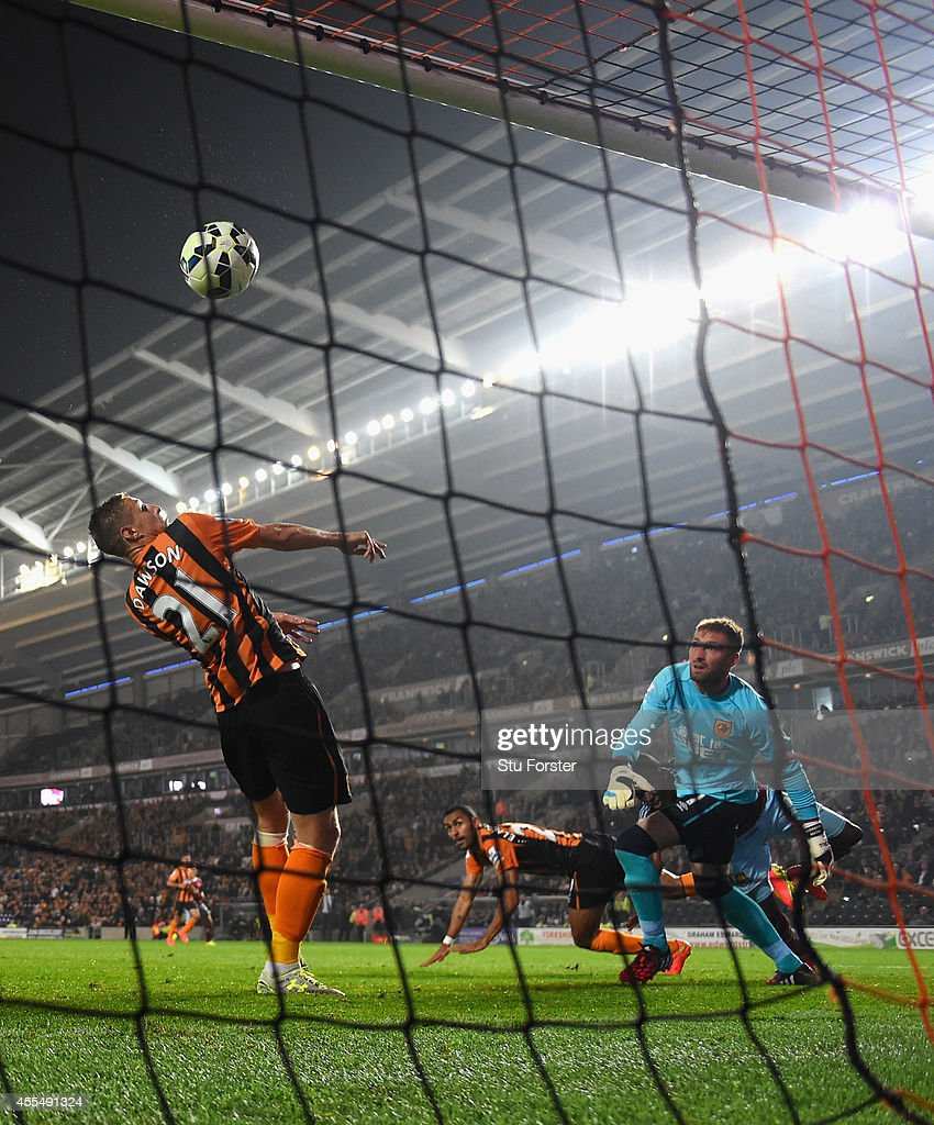 Hull defender Michael Dawson deflects a last minute chance over the bar during the Barclays Premier League match between Hull City and West Ham United at KC Stadium on September 15, 2014 in Hull, England.