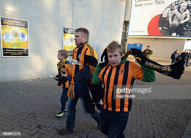 Hull fans make their way to the ground prior to the Barclays Premier League match between Hull City and Leicester City at KC Stadium on December 28...