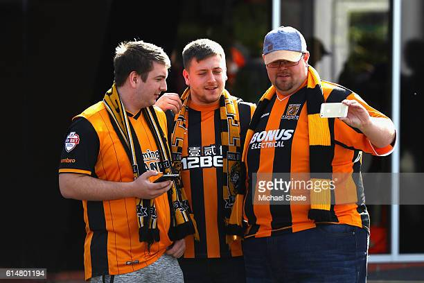 Hull fans pose for a selfie prior to the Premier League match between AFC Bournemouth and Hull City at Vitality Stadium on October 15 2016 in...