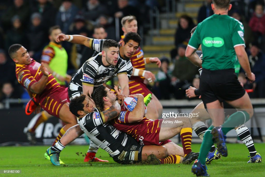 Hull FC Albert Kelly drags down Jake Mamo of Huddersfield Giants during the BetFred Super League match between Hull FC and Huddersfield Giants at KCOM Stadium on February 1, 2018 in Hull, England.