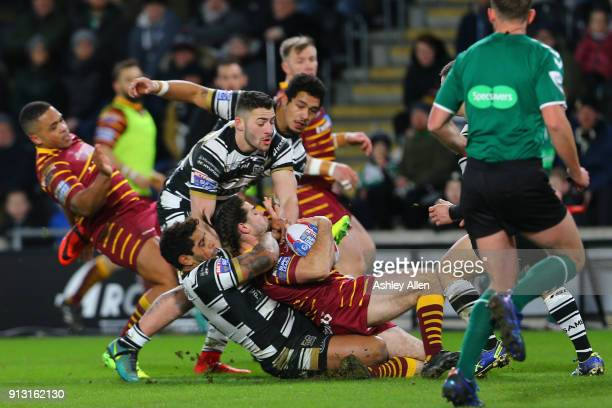 Hull FC Albert Kelly drags down Jake Mamo of Huddersfield Giants during the BetFred Super League match between Hull FC and Huddersfield Giants at...