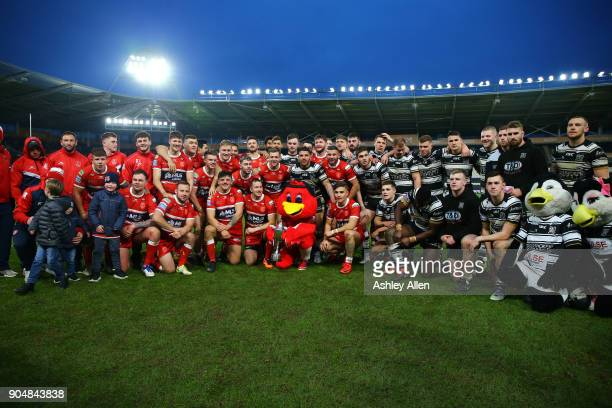Hull FC and Hull KR pose for a photo during the Clive Sullivan Trophy, pre-season friendly match between Hull FC and Hull KR at KCOM Stadium on...