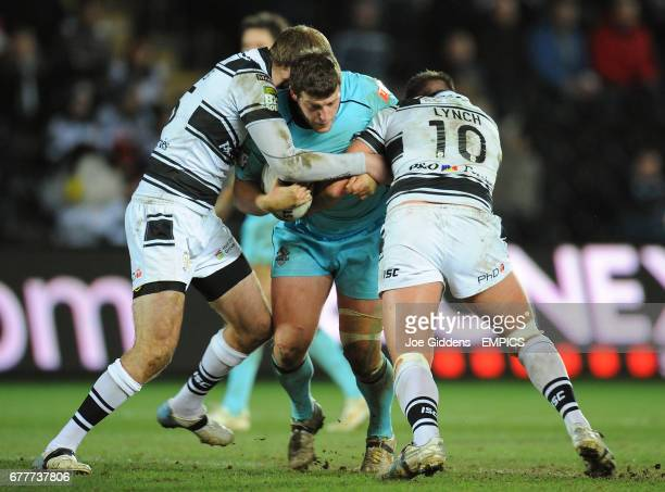 Hull FC's Andy Lynch and Richard Whiting tackle London Broncos' Tony Clubb