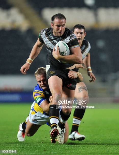 Hull FC's Andy Lynch is tackled by Leeds Rhinos' Paul McShane during the Super League match at the KC Stadium Hull
