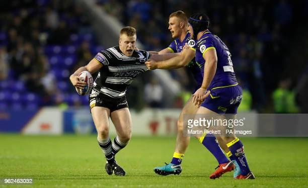 Hull FC's Brad Fash is tackled by Warrington Wolves' Jack Hughes and Chris Hill during the Betfred Super League match at the Halliwell Jones Stadium...