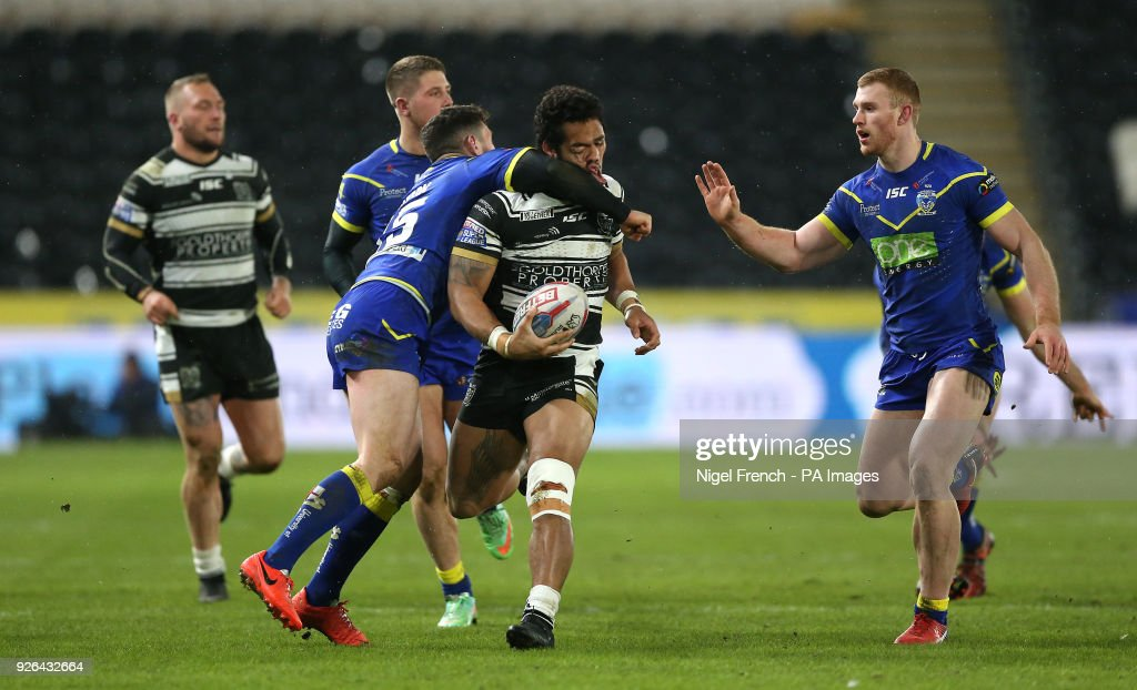 Hull FC's Bureta Faraimo is tackled by Warrington Wolves Joe Philbin leading to the latter receiving a red card during the Betfred Super League match at the KCOM Stadium, Hull.