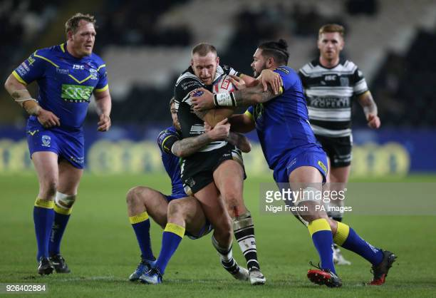 Hull FC's Dean Hadley is tackled by Warrington Wolves Ben MurdochMasila during the Betfred Super League match at the KCOM Stadium Hull