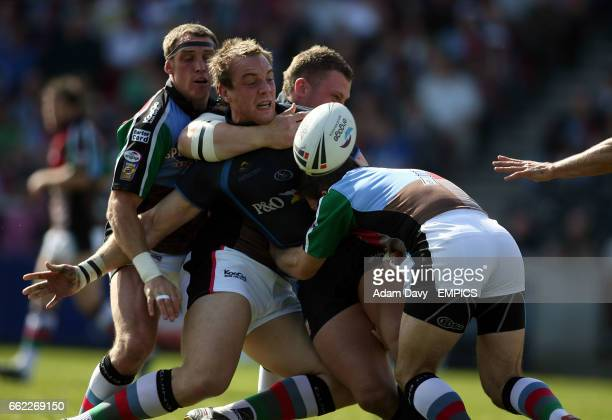 Hull FC's Ewan Dowes is tackled by Harlequins RL's David Mills and Danny Orr