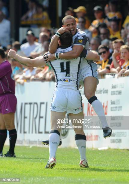 Hull FC's Kirk Yeaman celebrates with Jordan Tansey after scoring the opening try of the match during the engage Super League match at the The Jungle...