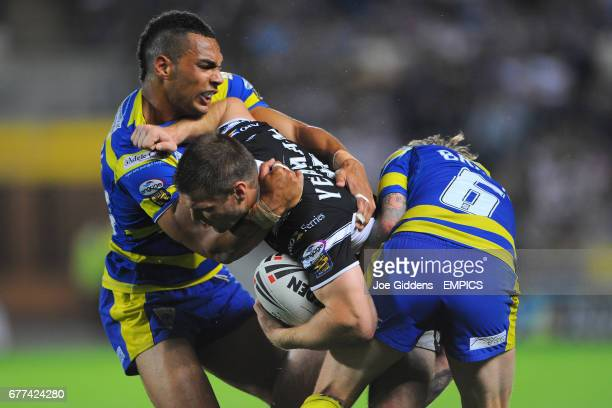Hull FC's Kirk Yeaman is tackled by Warrington Wolves' Ryan Atkins and Lee Briers