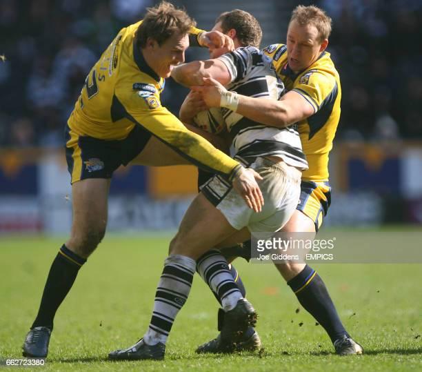 Hull FC's Lee Radford is stopped by Leeds Rhinos' Gareth Ellis and Carl Ablett