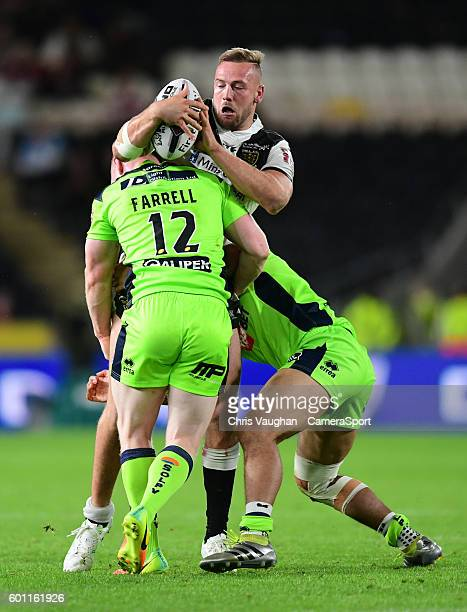Hull FC's Liam Watts is tackled by Wigan Warriors' Liam Farrell left and Wigan Warriors' Willie Isa during the First Utility Super League Super 8s...