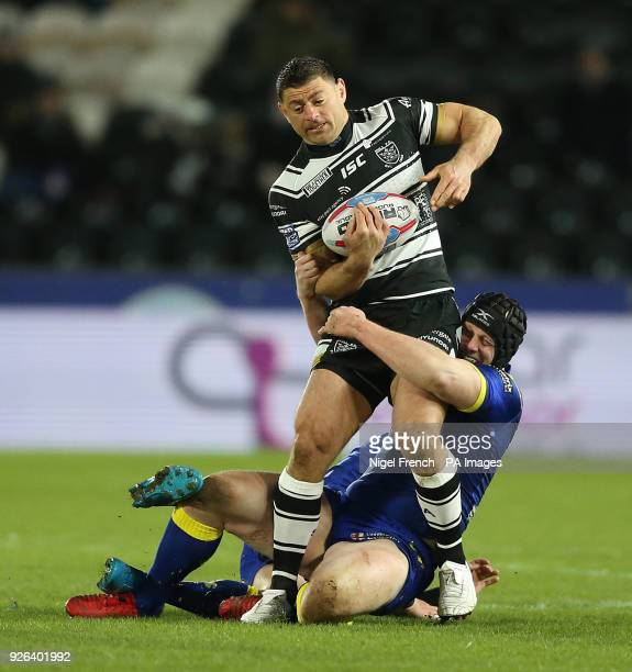 Hull FC's Mark Minichiello is tackled by Warrington Wolves Chris Hill during the Betfred Super League match at the KCOM Stadium Hull
