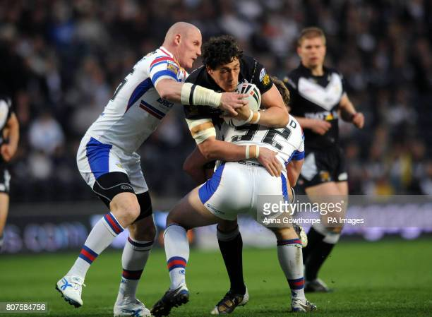 Hull FC's Mike Burnett is tackled by Wakefield's Richard Moore and Danny Kirmond during the engage Super League match at the KC Stadium Hull
