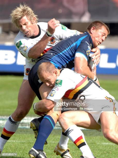 Hull FC's Richard Horne is tackled by Bradford Bull's Glenn Morrison and James Evans during the engage Super League match at Odsal Stadium Bradford