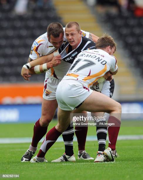 Hull FC's Richard Horne is tackled by Huddersfield Giants' Darrell Griffin and Danny Kirmond during the engage Super League match at the KC Stadium...