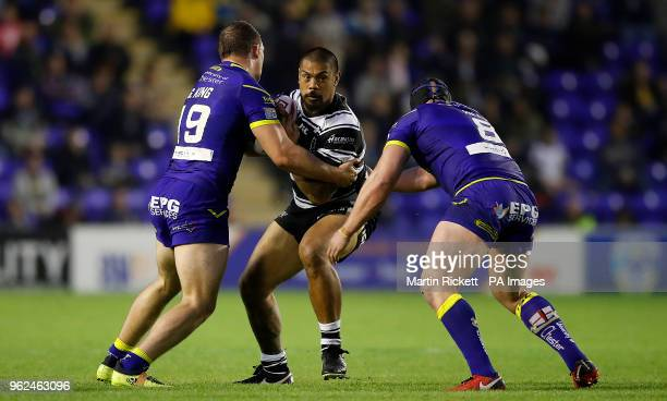 Hull FC's Sika Manu is tackled by Warrington Wolves' George King and Chris Hill during the Betfred Super League match at the Halliwell Jones Stadium...