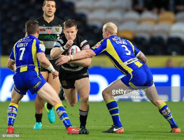 Hull FC's Steve Michaels is tackled by Warrington Wolves' Kurt Gidley and Ryan Atkins during the Betfred Super League match at the KCOM Stadium Hull
