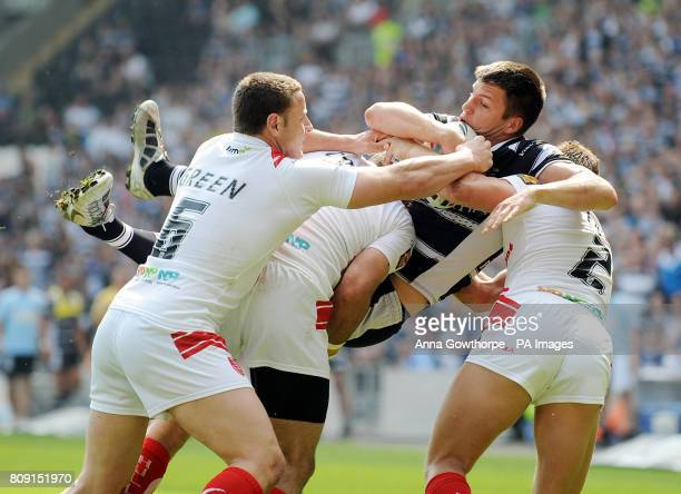 Hull FC's Tom Briscoe is lifted in the air by Hull KR's Blake Green Matt Cook and Peter Fox during the engage Super League match at the KC Stadium...