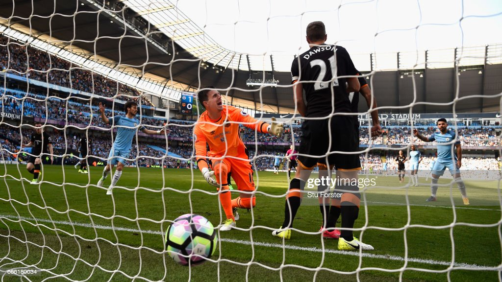 Hull goalkeeper Eldin Jakupovic reacts after Sergio Aguero (r) had given City a 2-0 lead during the Premier League match between Manchester City and Hull City at Etihad Stadium on April 8, 2017 in Manchester, England.