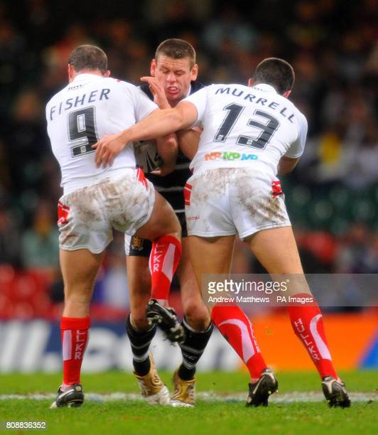 Hull Kingston Rovers' Ben Fisher and Scott Murrell combine to tackle Hull FC's Lee Radford during the Engage Super League match at the Millennium...