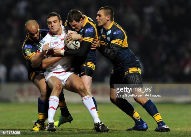 Hull Kingston Rovers' Craig Hall is tackled by Leeds Rhinos' Jamie JonesBuchanan Zak Hardaker and Ryan Hall