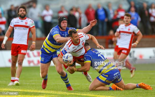 Hull Kingston Rovers' Danny McGuire is tackled by Warrington Wolves' Chris Hill and Joe Philbin during the Coral Challenge Cup Quarter-Final match...