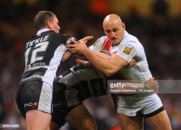 Hull Kingston Rovers' Mick Vella is tackled by Hull FC's Danny Tickle and Sam Moa during the Engage Super League match at the Millennium Stadium...