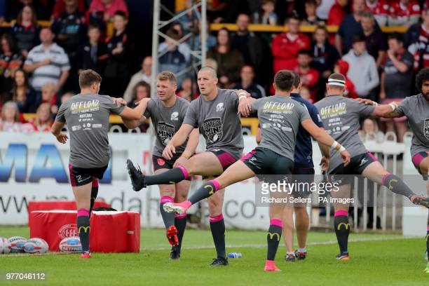 Hull KR players warm up with Offload state of mind tshirts during the Betfred Super League match at the MendAHose Jungle Casteford