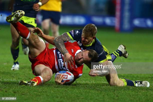 Hull KR's Adam Quinlan is tackled by Tom Johnstone of Wakefield Trinity during the BetFred Super League match between Hull KR and Wakefield Trinity...