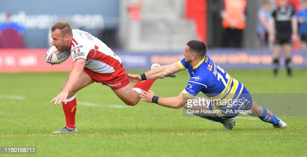 Hull KR's Ben Crooks is tackled by Warrington Wolves's Ben Currie during the Betfred Super League match at Craven Park, Hull.