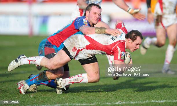 Hull KR's Ben Fisher goes over to score a try under pressure from Wakefield's Dale Ferguson during the engage Super League match at Craven Park Hull