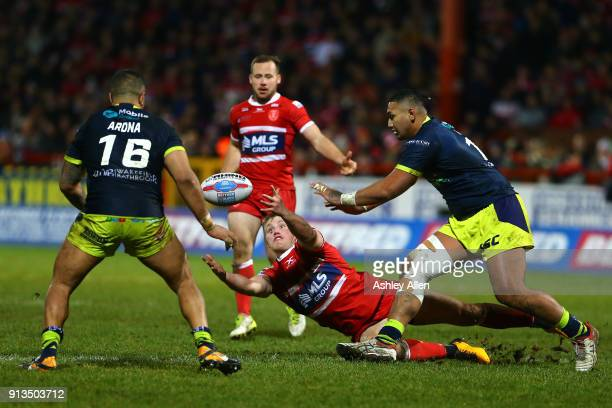 Hull KR's Connor Williams loses control of the ball as Wakefield Trinity's Justin Horo and Tinirau Arona⨠move in to gather the ball during the...