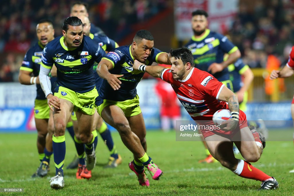 Hull KR's Justin Carney (R) pushes aside Reece Lyne (L) of Wakefield Trinity during the BetFred Super League match between Hull KR and Wakefield Trinity at KCOM Craven Park on February 2, 2018 in Hull, England