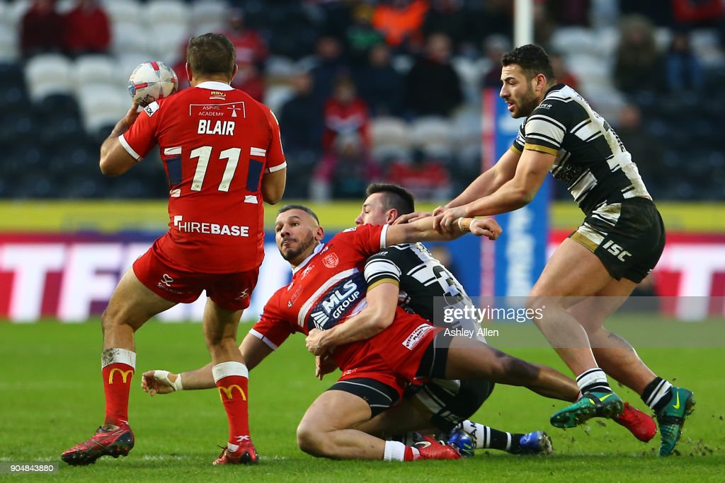 Hull KR's Liam Salter is tackled by Hull FC's Jack Sanderson during the Clive Sullivan Trophy, pre-season friendly match between Hull FC and Hull KR at KCOM Stadium on January 14, 2018 in Hull, England.