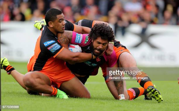Hull KR's Mosew Masoe is tackled by Castleford Tigers Junior Moors during the Betfred Super League match at the MendAHose Jungle Casteford