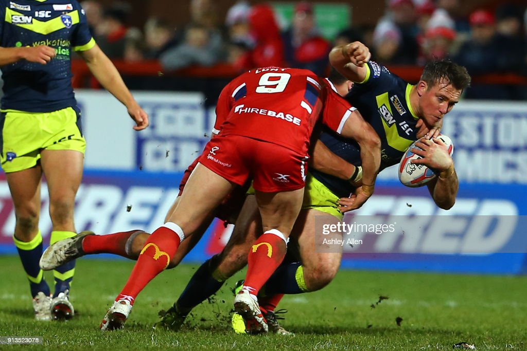 Hull KR's Shaun Lunt tackles Wakefield Trinity's Tyler Randell during the BetFred Super League match between Hull KR and Wakefield Trinity at KCOM Craven Park on February 2, 2018 in Hull, England