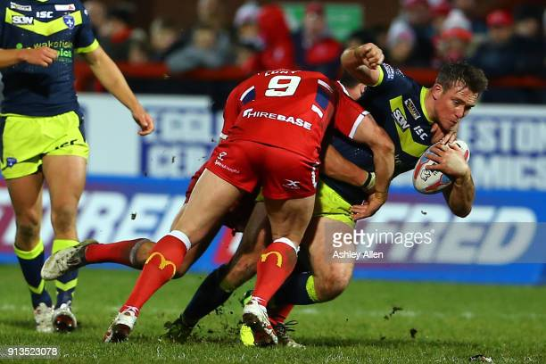 Hull KR's Shaun Lunt tackles Wakefield Trinity's Tyler Randell during the BetFred Super League match between Hull KR and Wakefield Trinity at KCOM...