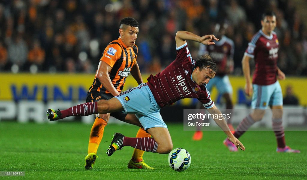 Hull player Jake Livermore (l) challenges Mark Noble of West Ham during the Barclays Premier League match between Hull City and West Ham United at KC Stadium on September 15, 2014 in Hull, England.